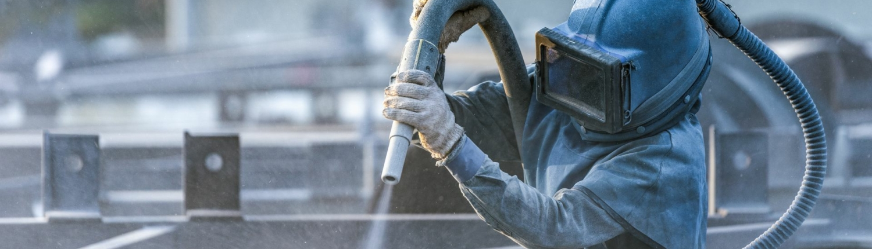 Povrchová úprava a ochrana kovových konstrukcí tryskáním a metalizací